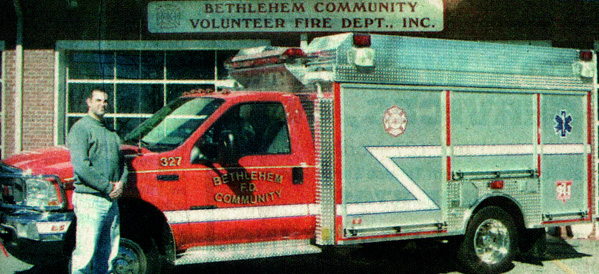 Bethlehem Community Volunteer Fire Department Chief Shanon Lowrance stands beside a new Anchor-Richey firetruck.
